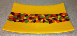 "Warm yellow, green, orange and red platter: Item number 46: 7"" by 16"""