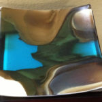 "Natural blend of glass (blue, green, brown and vanilla). Item number 57: 10"" by 10"""