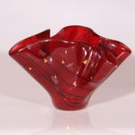 "Red and black vase. Item number 99: 9"" by 6"""