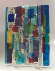 """Strokes of every color in the rainbow make up this display piece for either the wall or in a stand. Item #181: 9"""" by 6 3/4"""". Price: $45"""