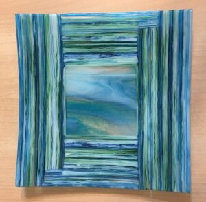 """On edge"" showpiece plate reminds you of the most beautiful ocean views. Item number 194: 10"" by 10"". Price: $150"