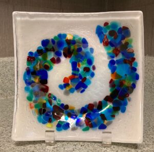 """Beautiful white and clear irid """"wave"""" display piece with blues, greens, purples, yellows, reds and oranges. Item number 192: 7 1/2"""" square. Cost: $35.00"""
