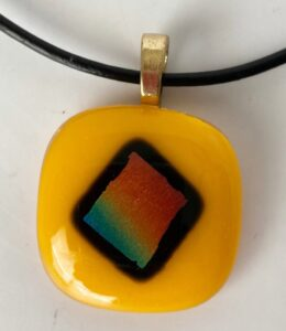 """Fun warm yellow pendant with dichroic rainbow. Item number N60: 1"""" x 1"""" inches. Price: $15"""