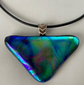 """Gorgeous dichroic pendant with all the colors in the rainbow. Finished with a modern hanger. Item number N61: 2 1/4"""" x 1 1/2"""" inches. Price: $25"""