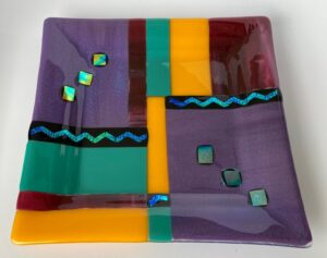 """One of my favorite color combinations! A modern show piece combining opaque purple, green, warm yellow and cranberry glass with dichroic glittering throughout. Item number 160: 10"""" square. Cost: $45"""