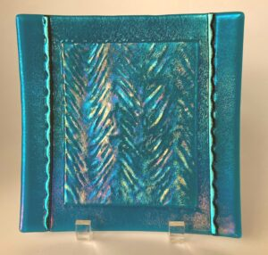 """Beautiful turquoise and clear textured irid plate with dichroic lines. Item number 197: 8"""" square. Price: $65.00"""