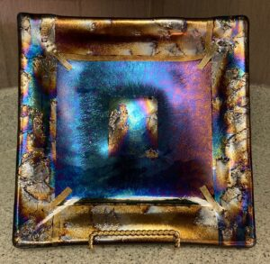 """This show stopper rainbow is even more beautiful in person! It is mixed textured irid plate. Item number 283: 9 1/2 by 9 1/2"""". Price: $75.00"""